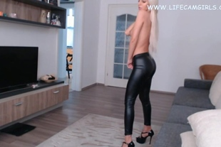 Sexy blonde takes off her leather leggings and orgasm.